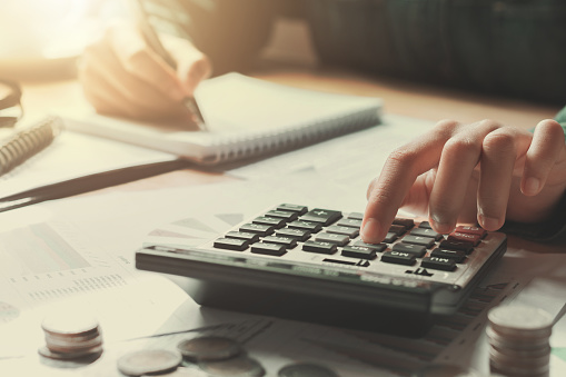 Close up of a businesswoman using a calculator